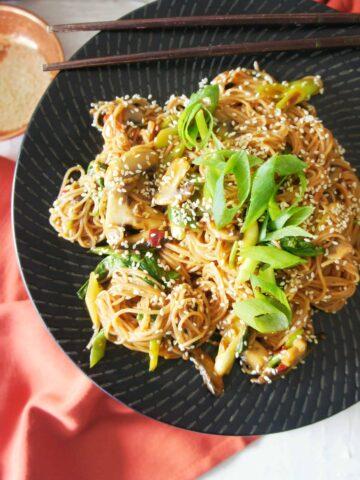 Vegan Brown Rice Noodles on a black plate