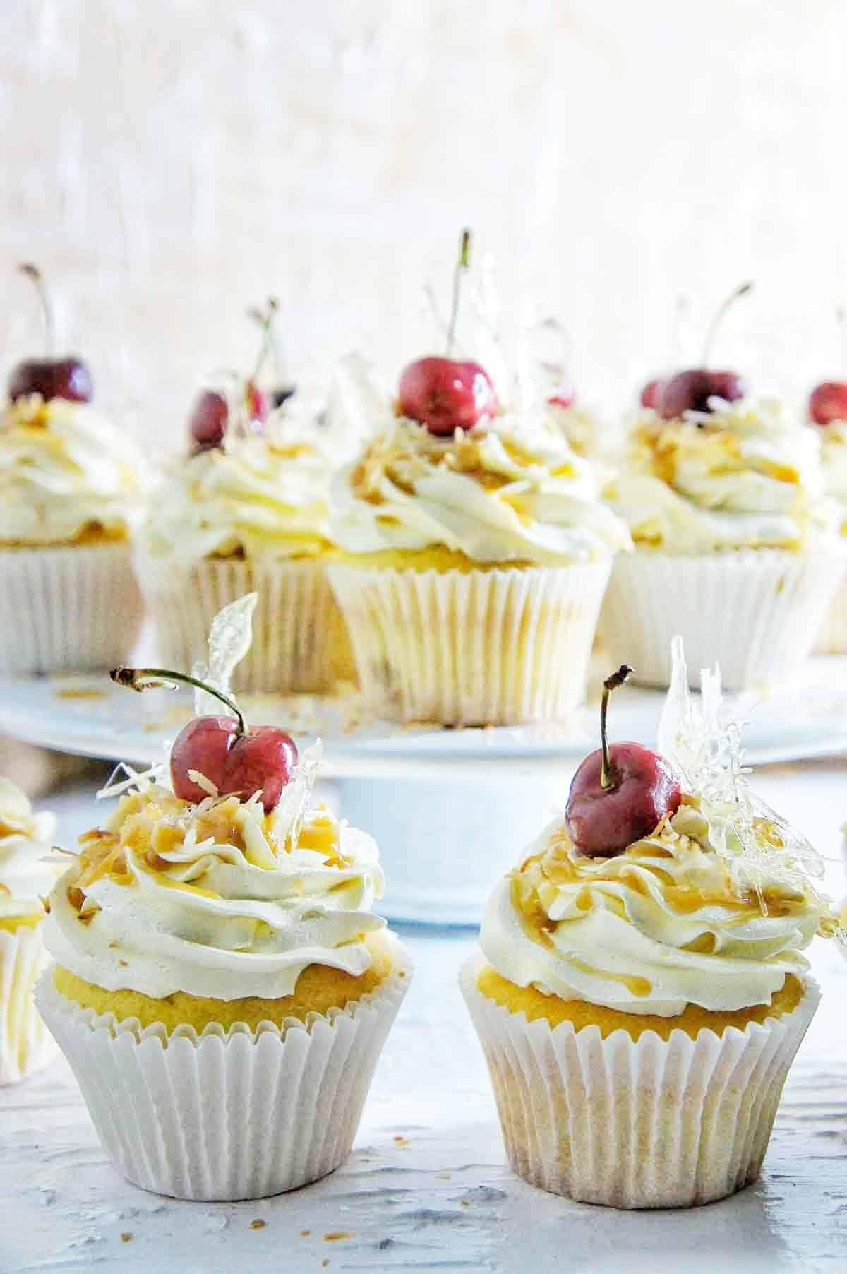 Mistletoe Cupcakes with cherries on top