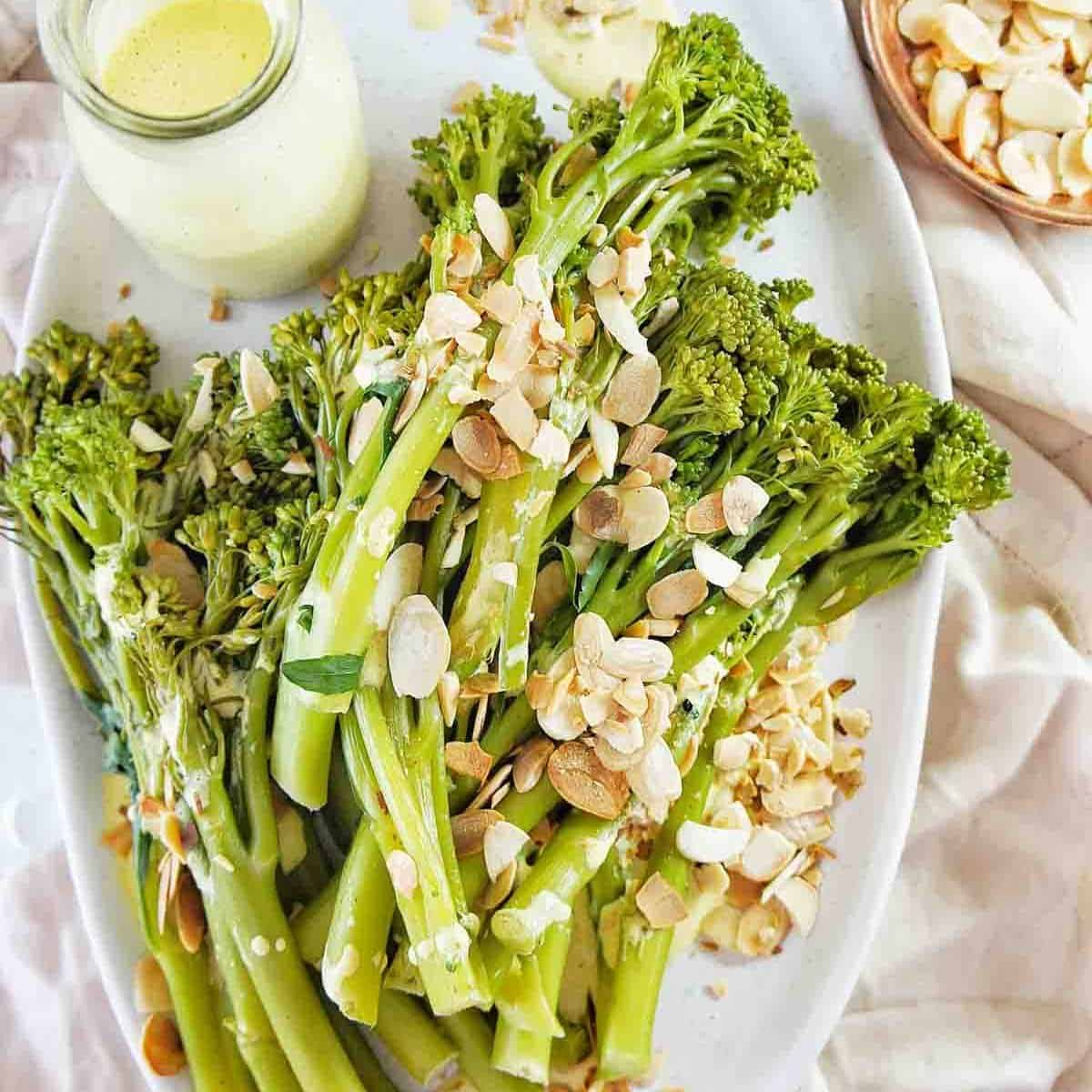 Steamed Broccolini on a white plate