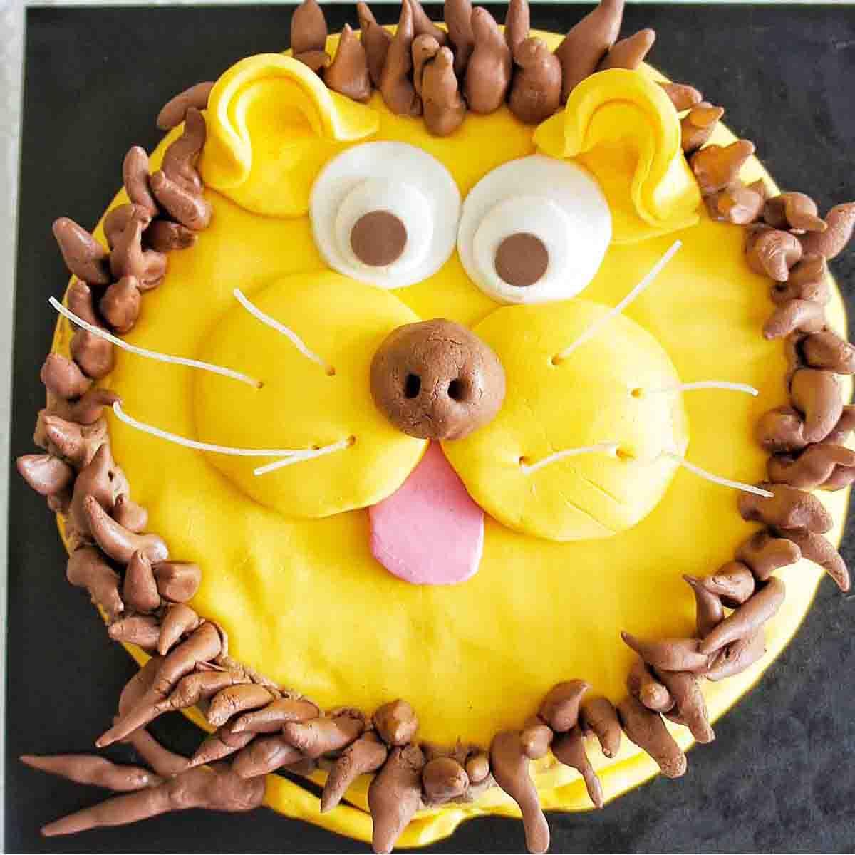 Lion Cake on a black cake board