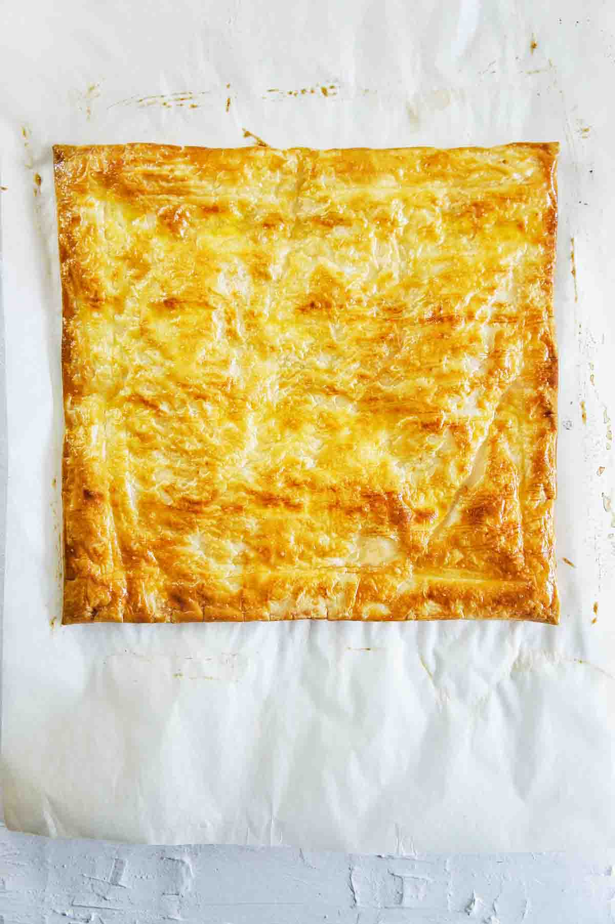 Passionfruit Tart process shot showing cooked puff pastry on a white background