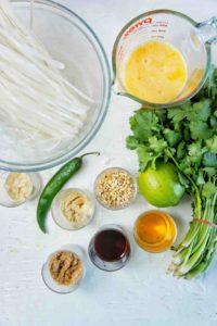 Tofu Pad Thai ingredients on white background