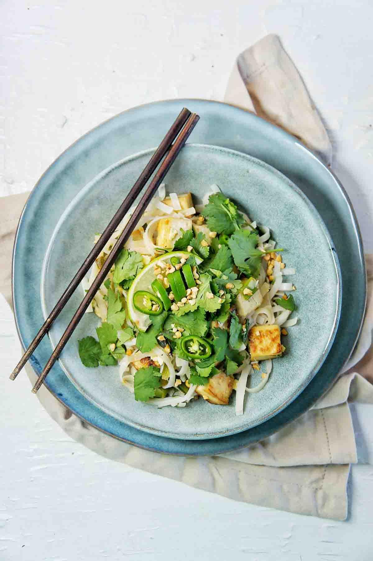 Tofu Pad Thai in a blue bowl with chopsticks