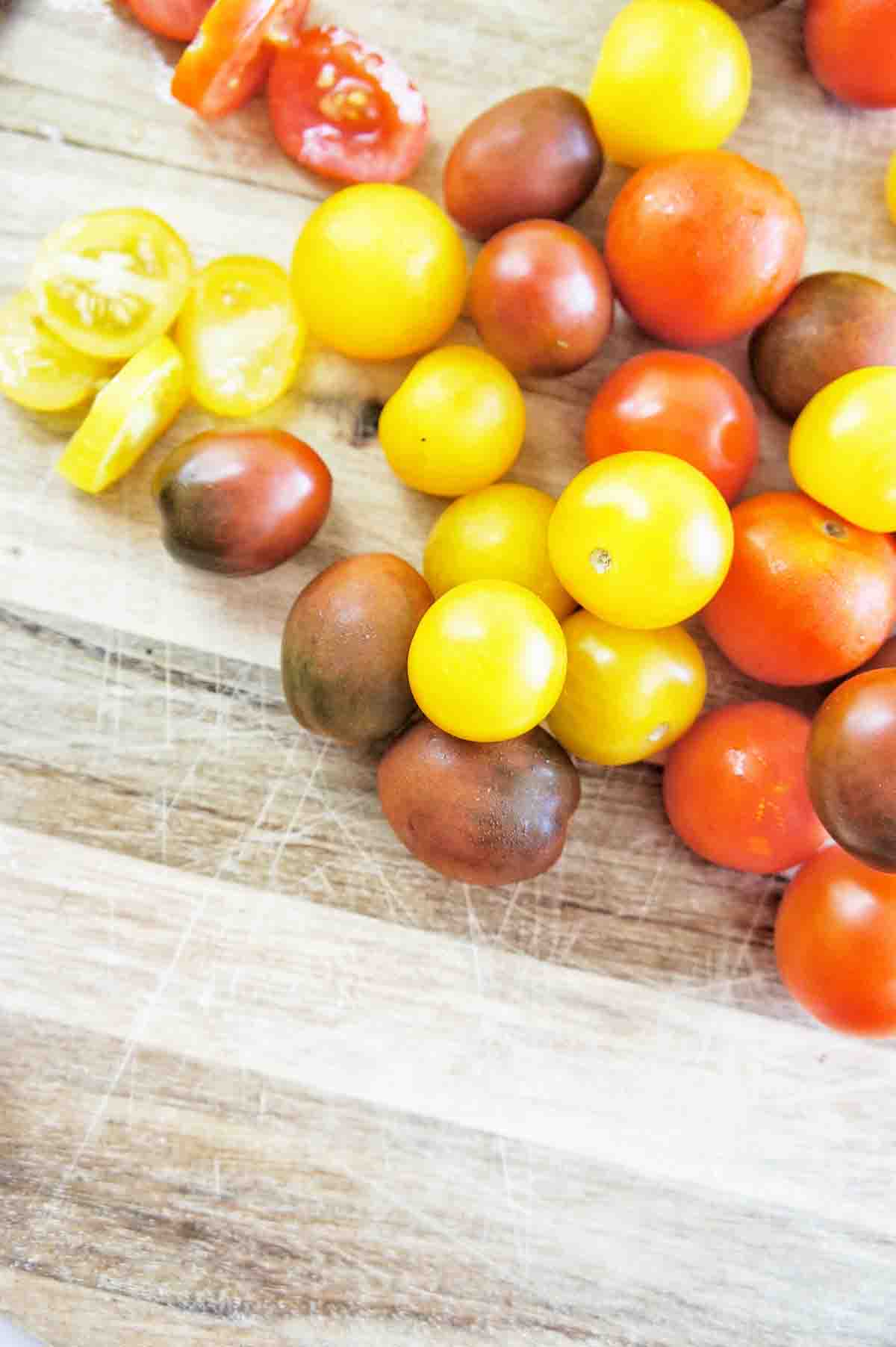 Heirloom tomatoes on a wooden chopping board