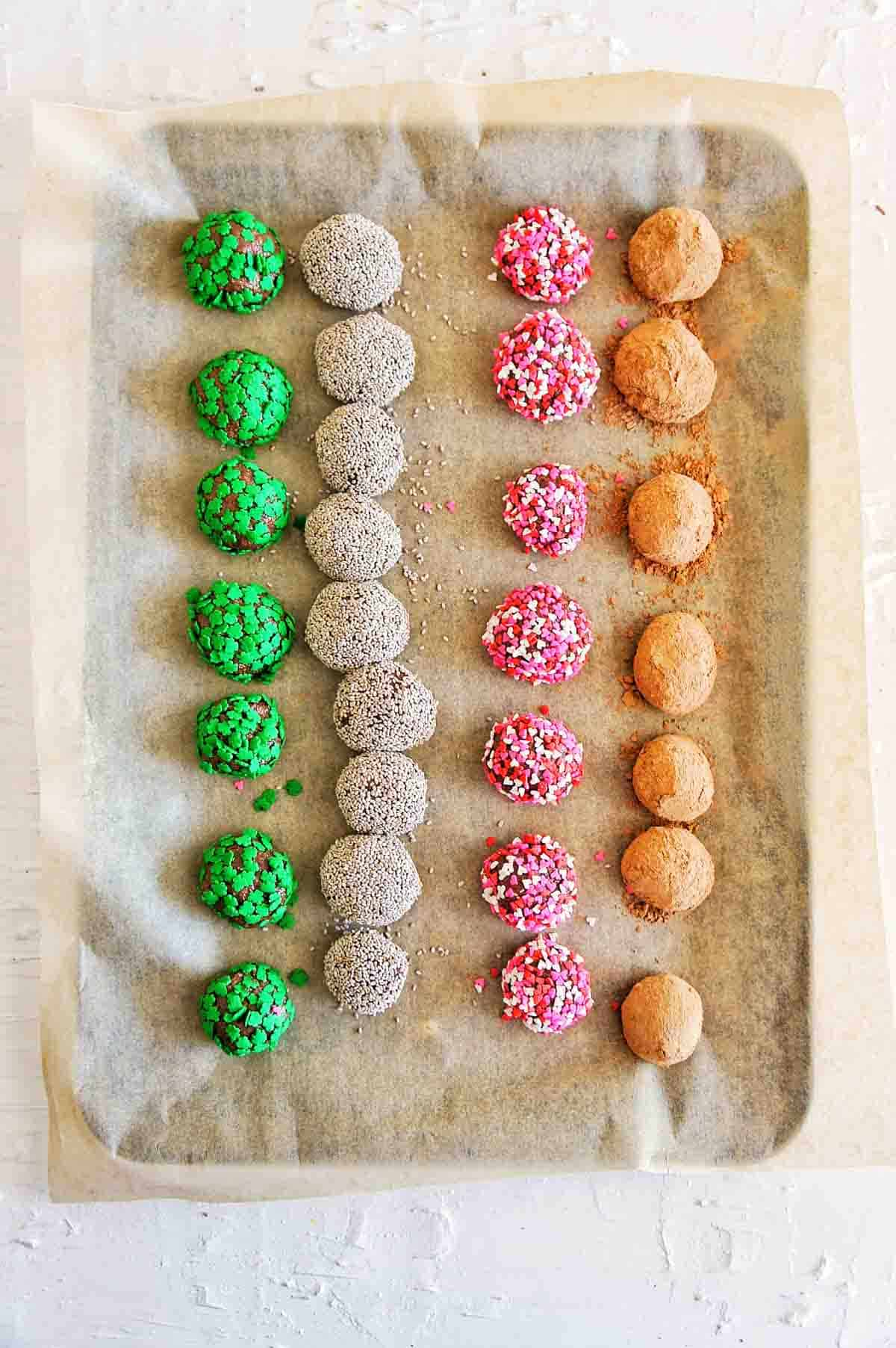 A baking tray with rows of bliss balls