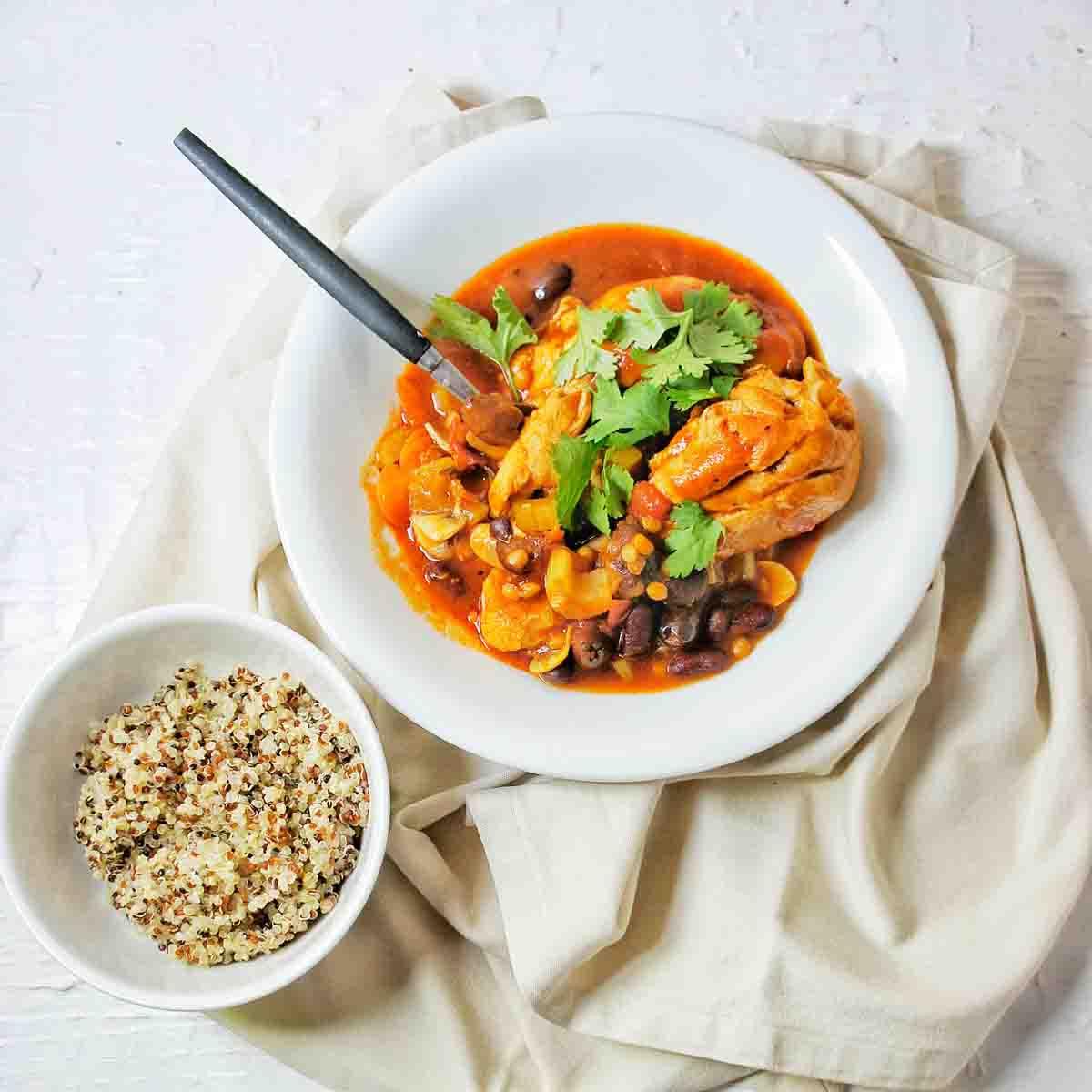 Chicken Cacciatore with quinoa in a small white side bowl