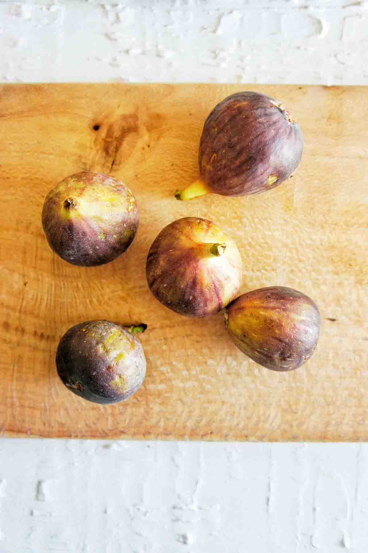 Fresh figs on a timber chopping board