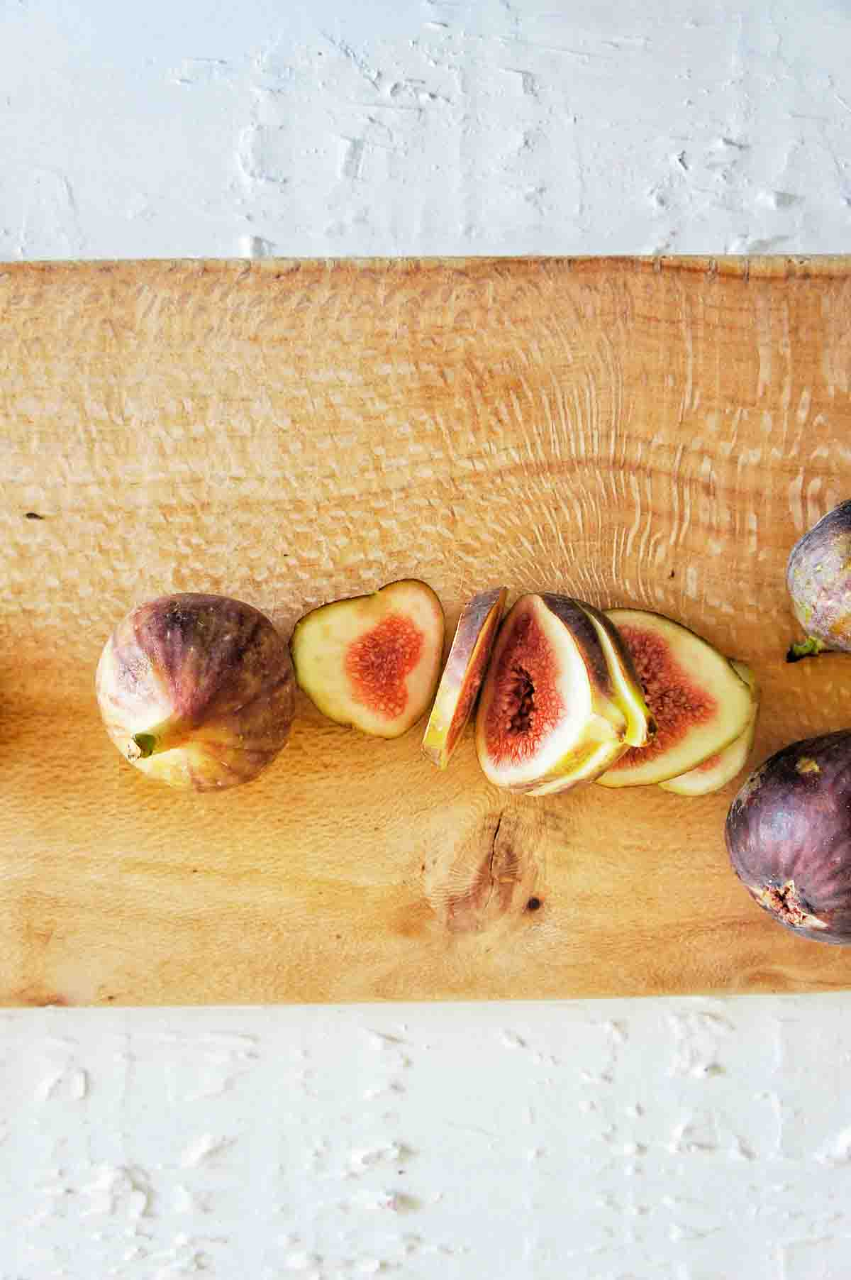 Sliced Figs on a timber chopping board