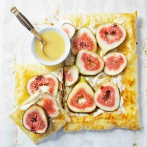 Fig Tart Feature image showing tart on white background with small bowl of marmalade syrup