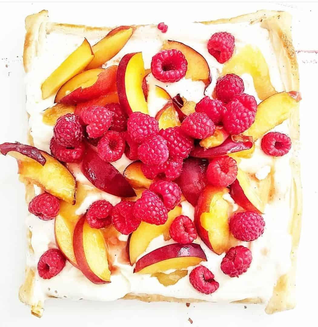 Nectarine Raspberry Tart on white background cropped image