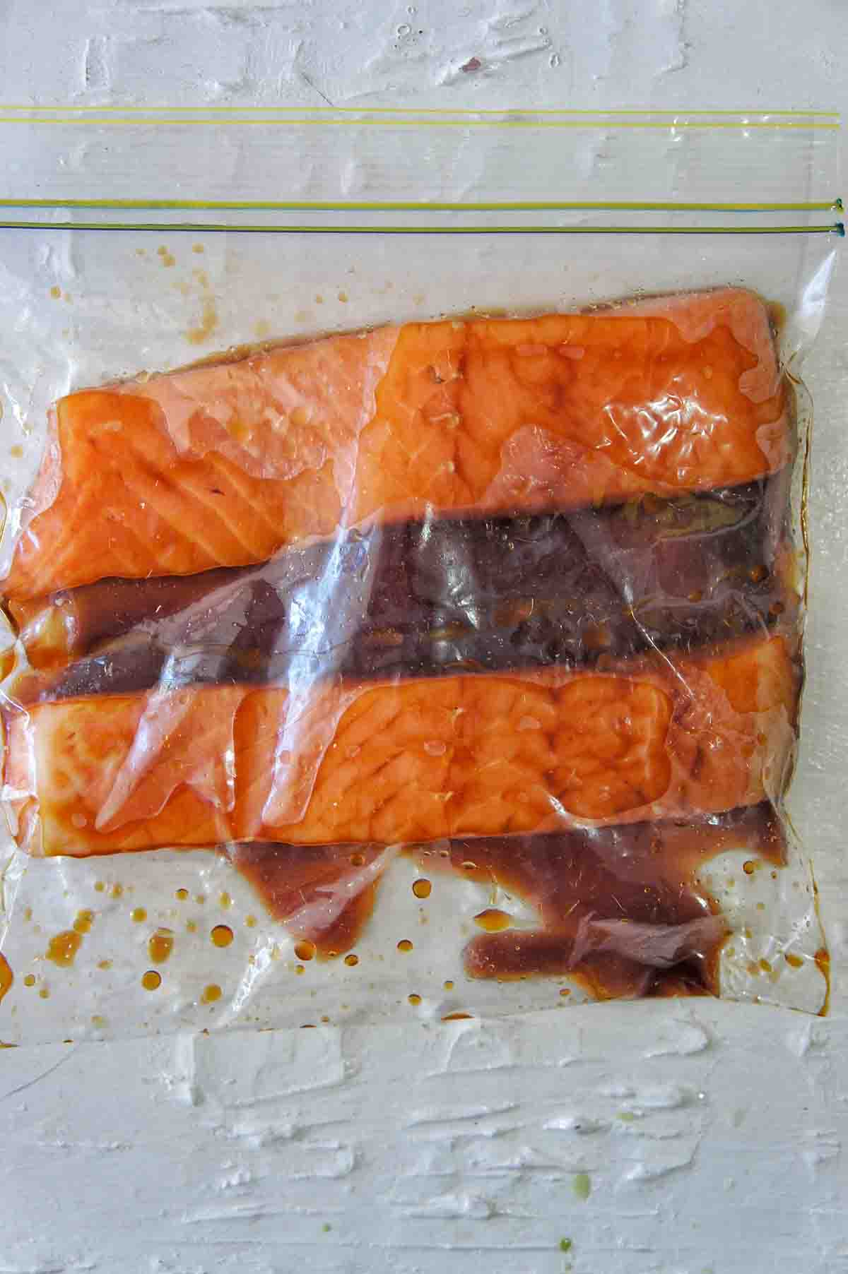 Salmon fillets marinading in a zip lock bag