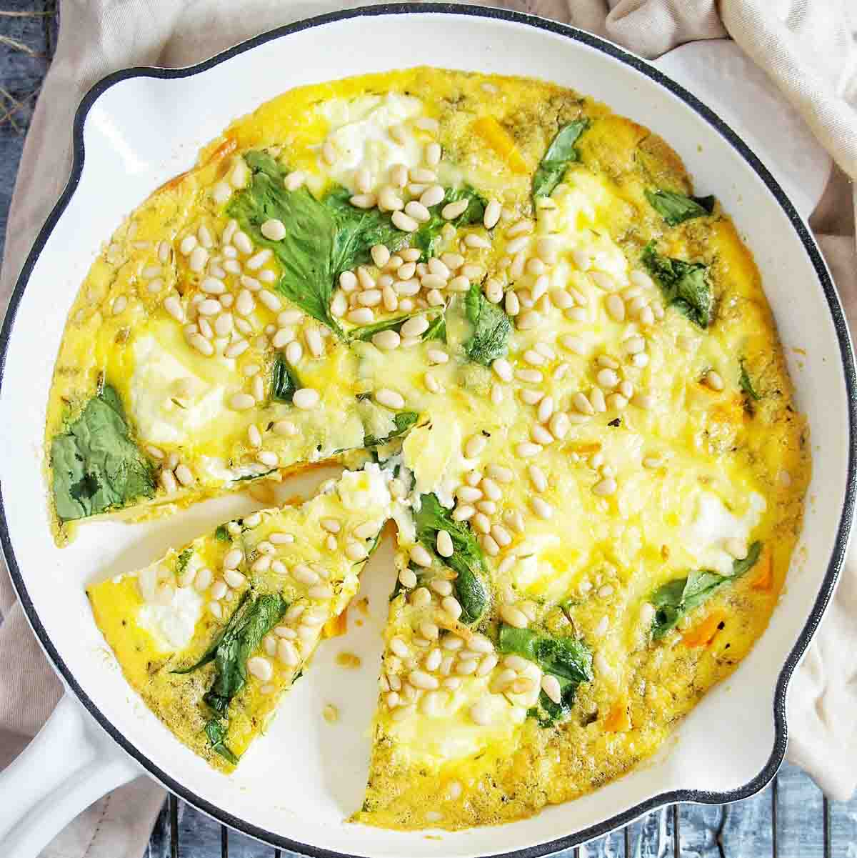 Pumpkin Frittata in a white skillet cropped image
