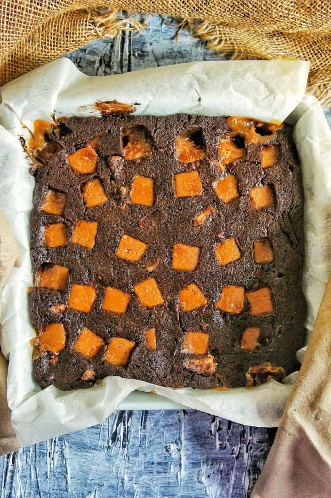 Cooked caramel brownie in baking dish