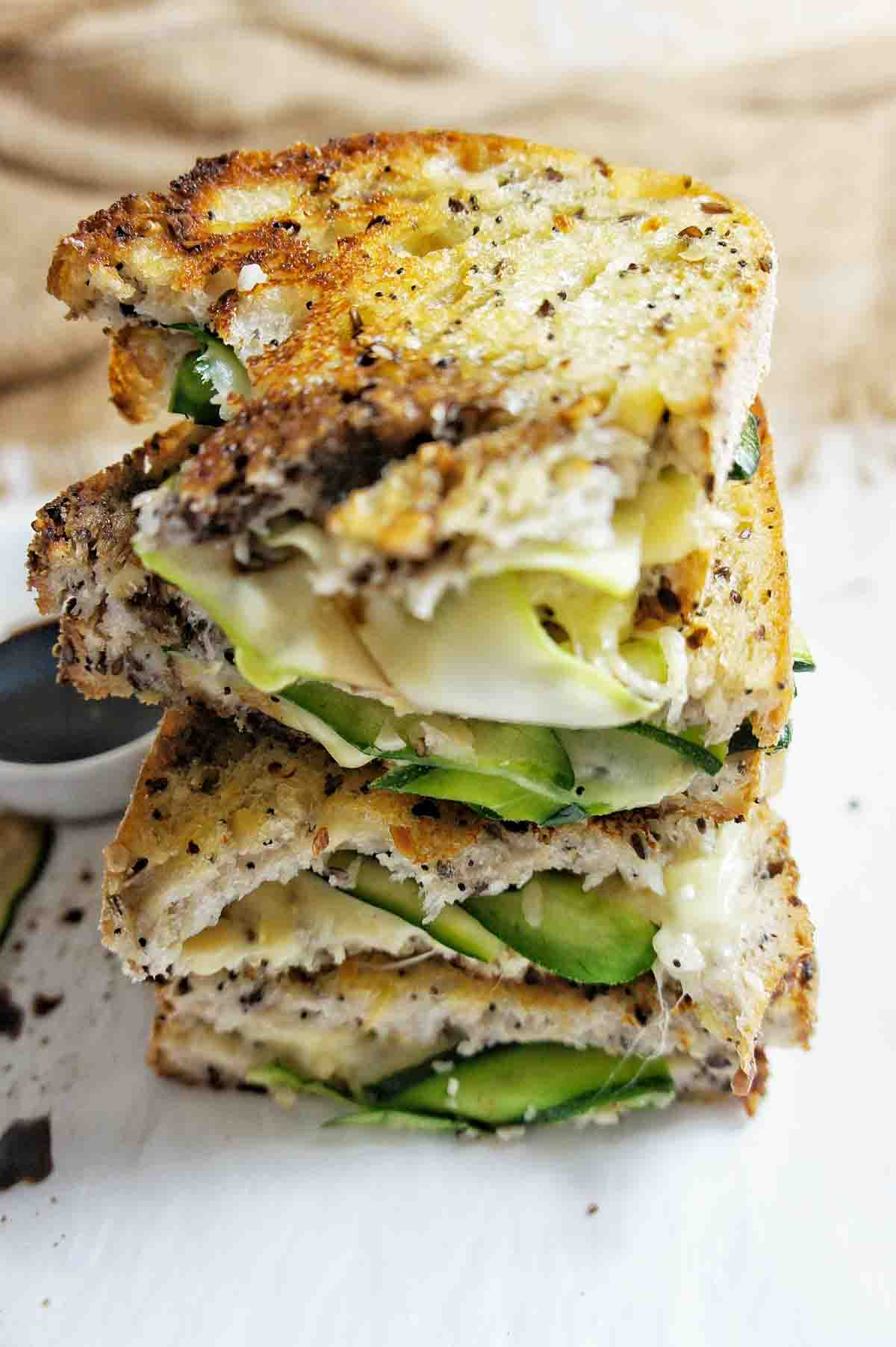 Stack of zucchini grilled cheese sandwich halves