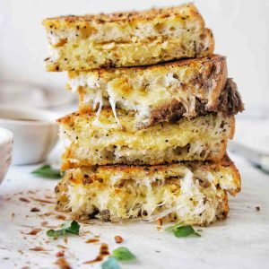 Cheese and Onion Sandwich stack with cheese oozying out
