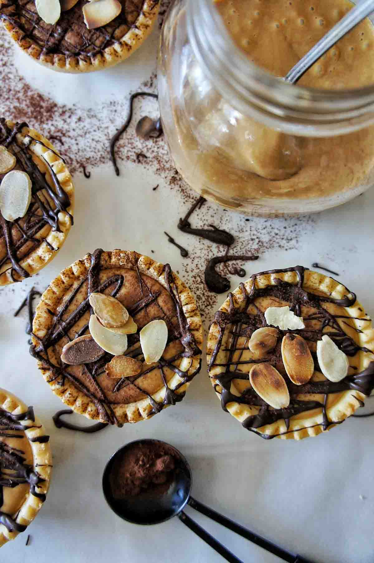 Easy tartlets with dulce de leche sauce in jar in the top right corner