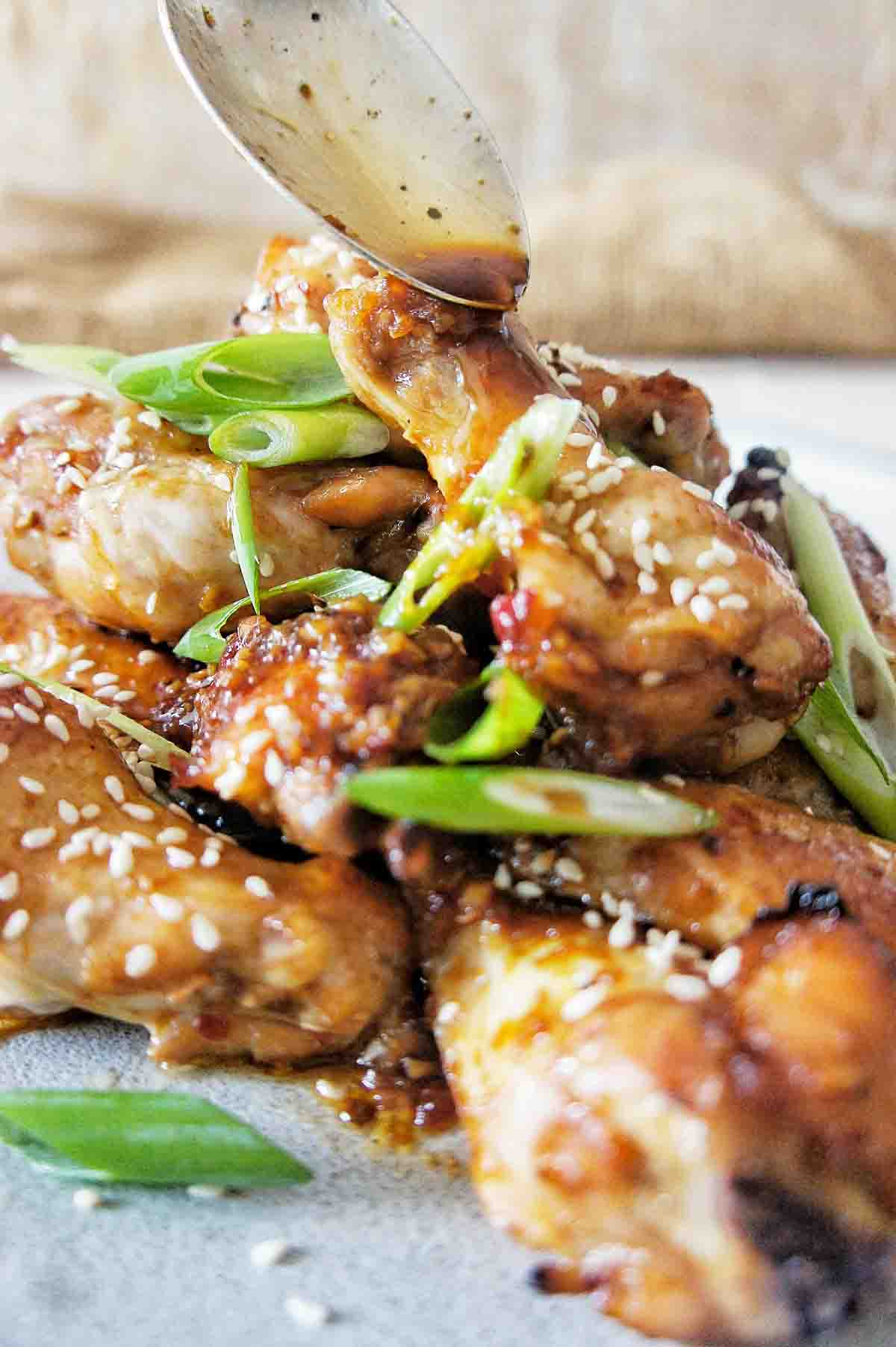 Honey Soy Chicken Wings piled high on a grey plate