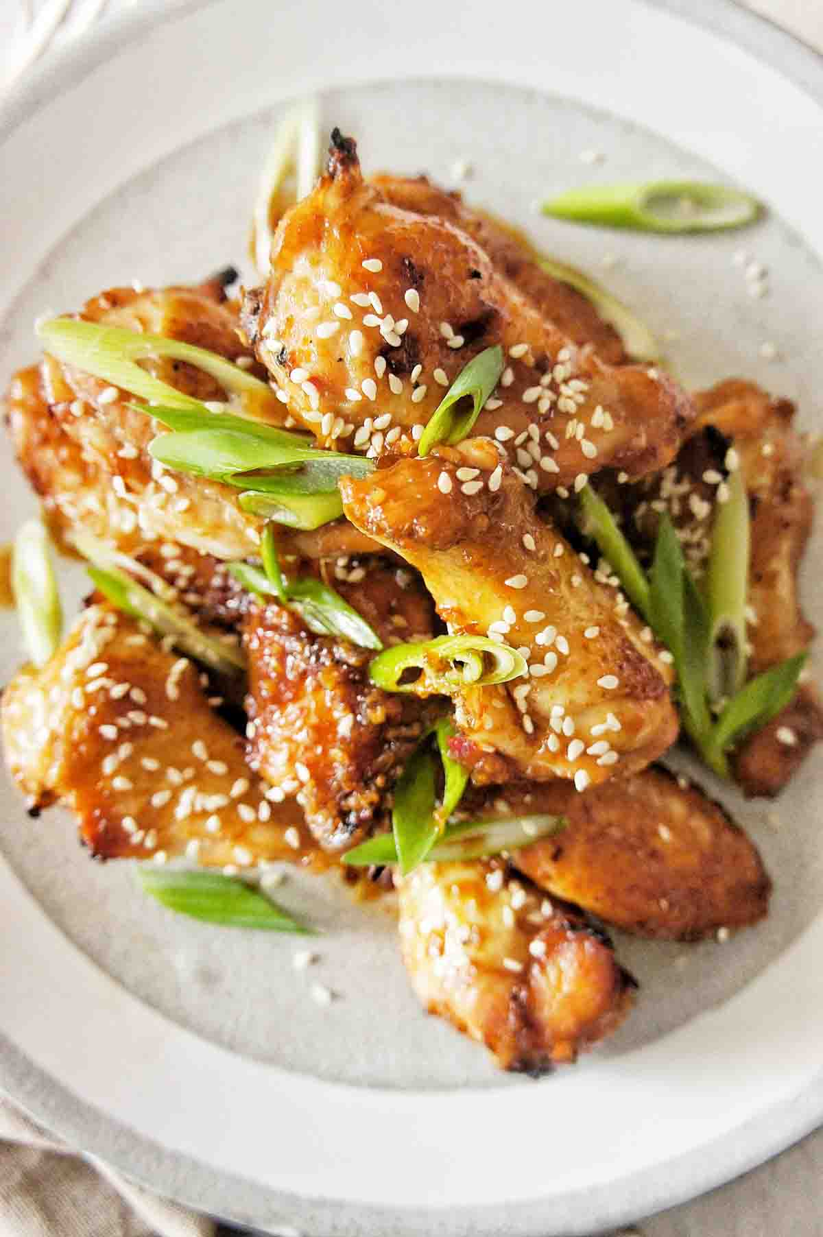 Photo from above Honey Soy Chicken Wings on a grey plate