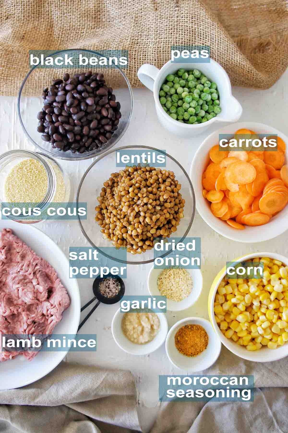 Ingredients set out to make moroccan lamb couscous with text overlay