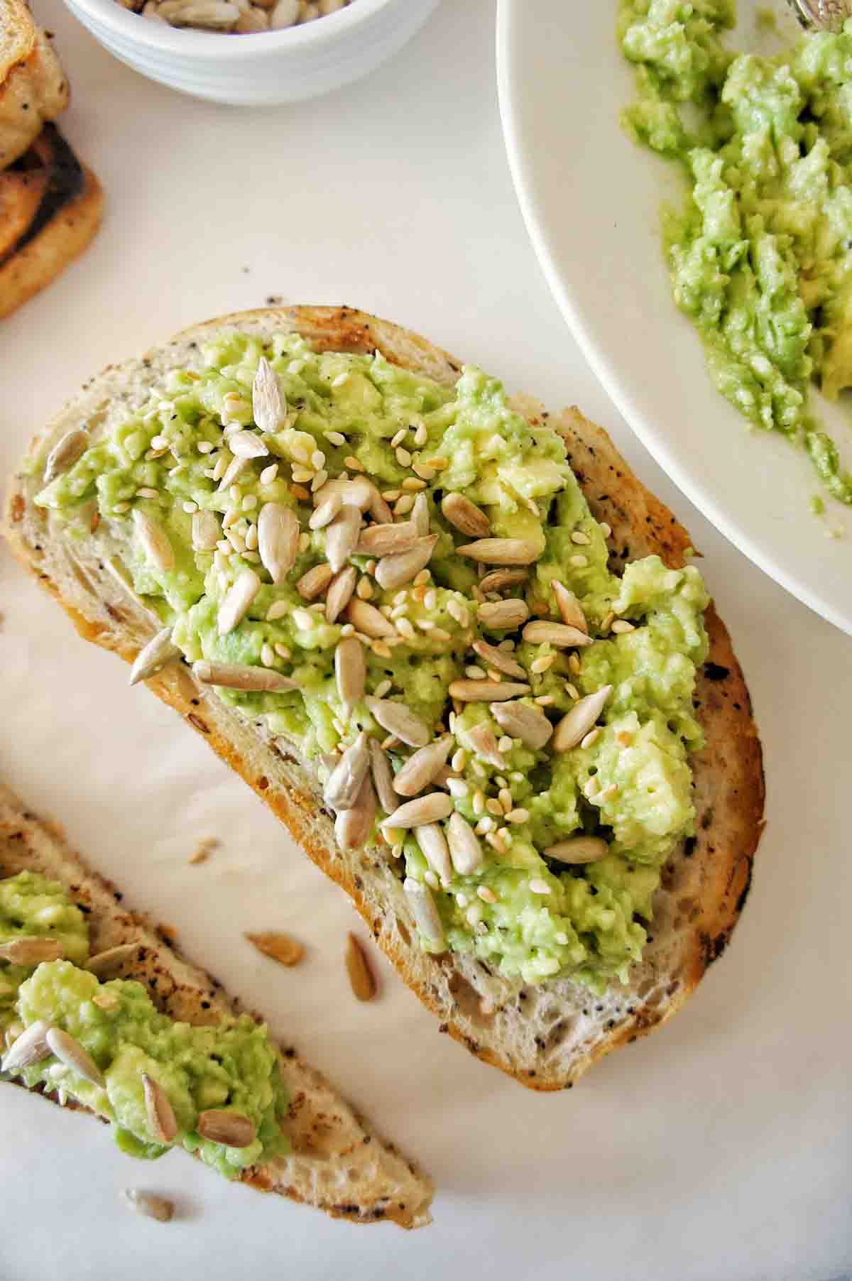 Avocado on toast with toasted sesame and sunflower seeds