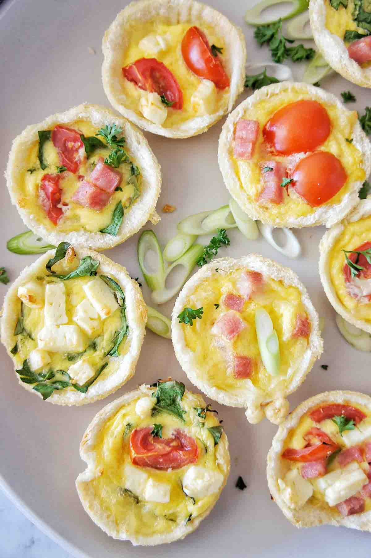 Mini Quiches on a pale cream plate