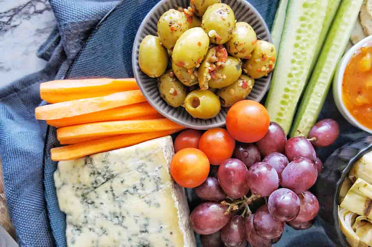 Grazing Platter with olives, cheese, carrots and grapes