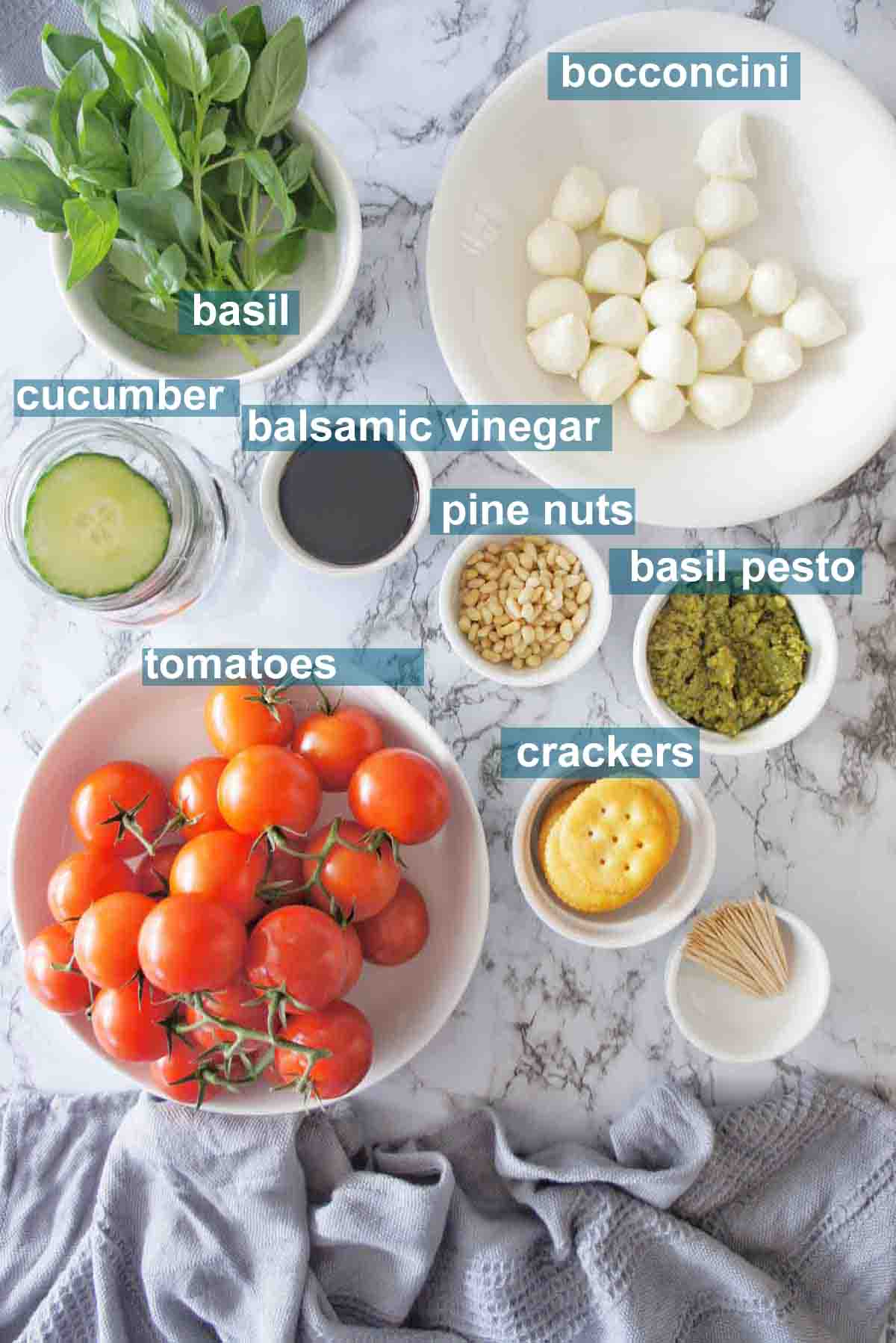 Ingredients needed for caprese bites with text overlay
