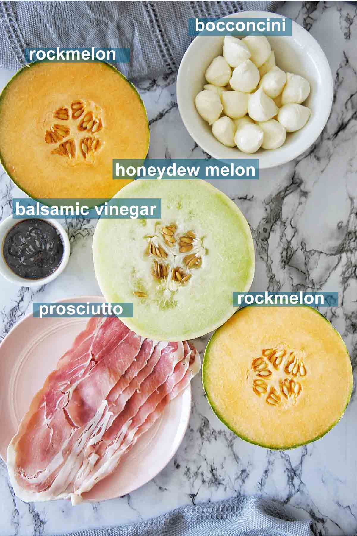 Ingredients needed for melon prosicutto skewers with text labels