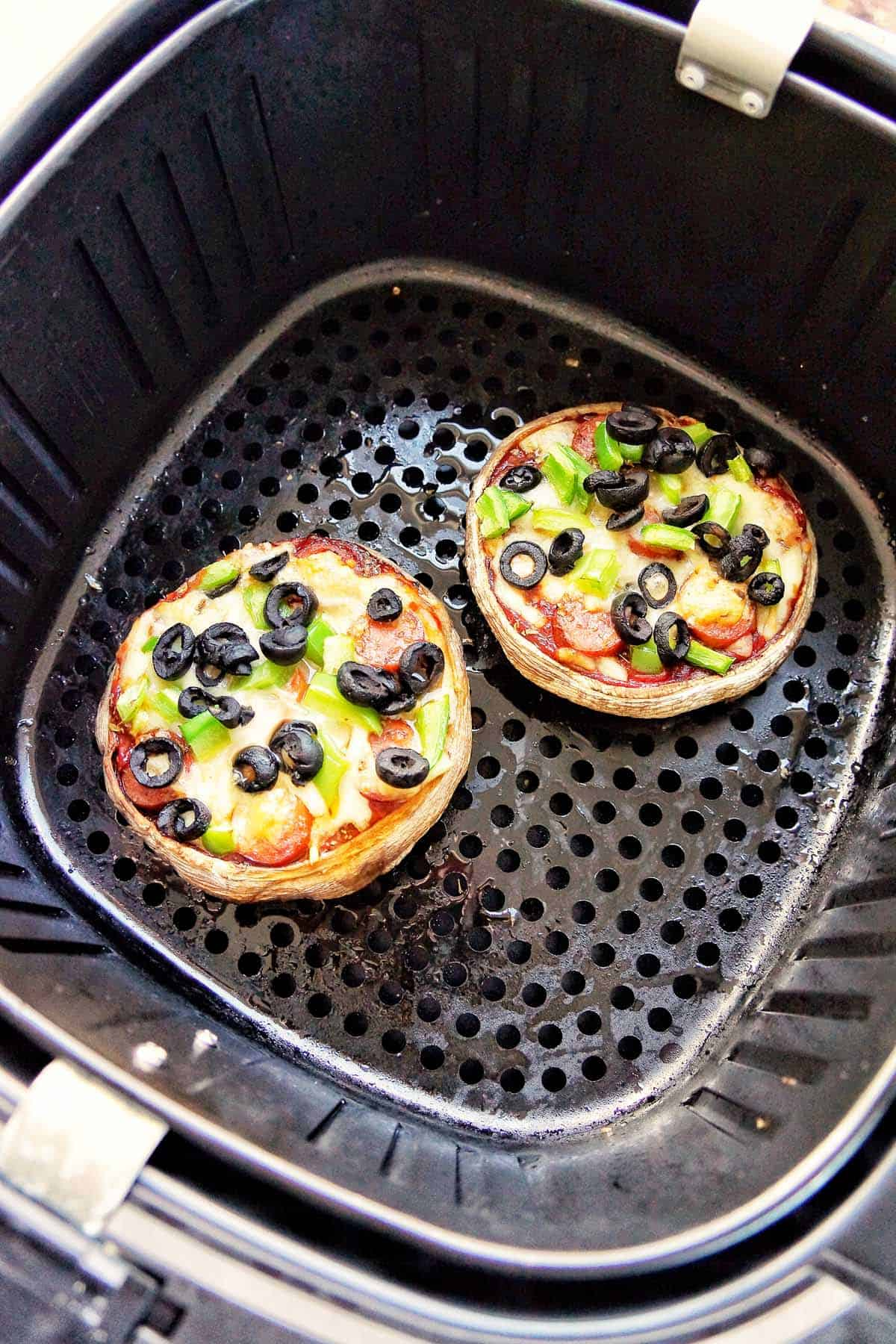 Cooked Portobello Pizzas in Air Fryer basket