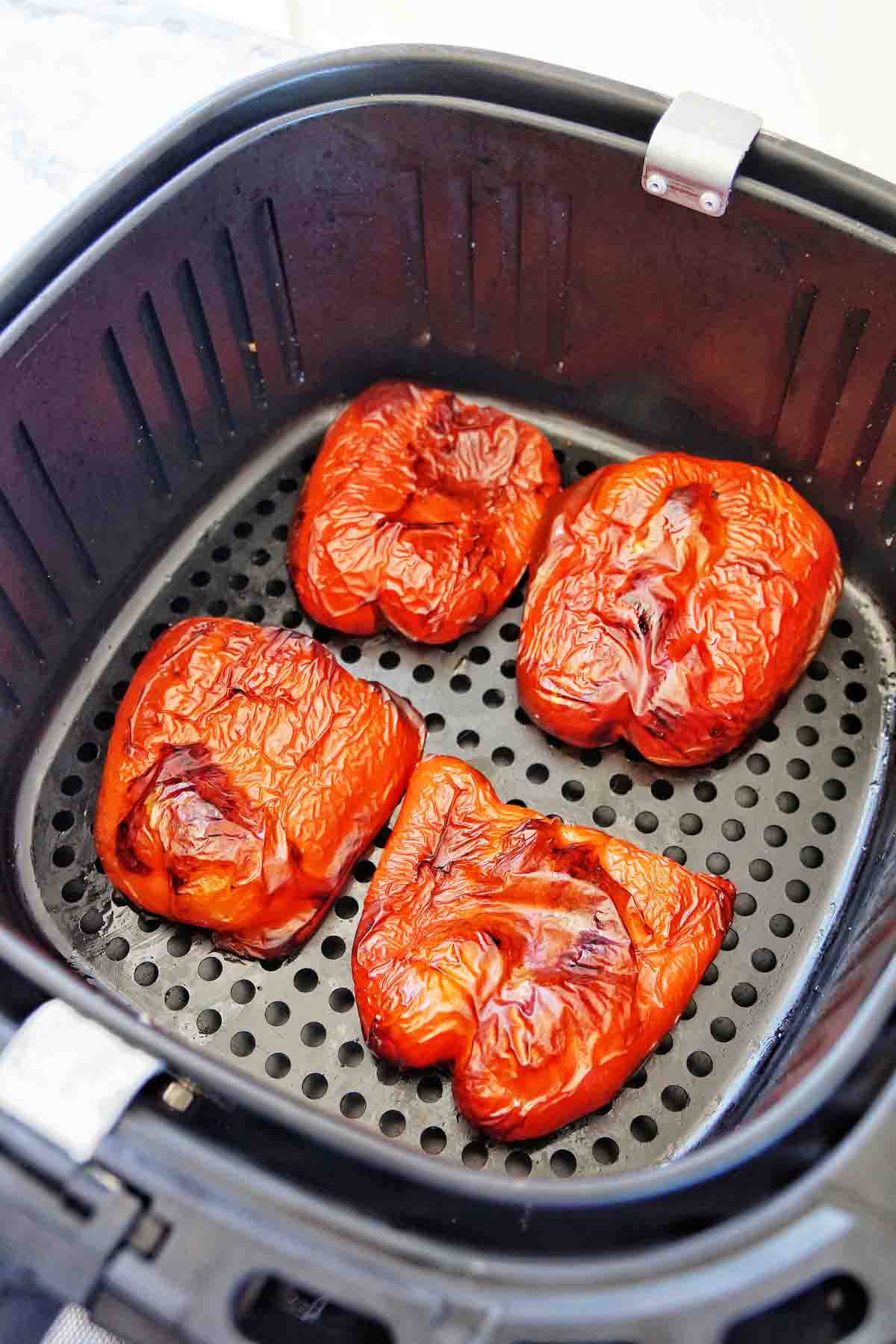 Roasted Red Peppers in Air Fryer Basket