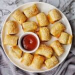 Air Fryer Sausage rolls on a white plate with sauce