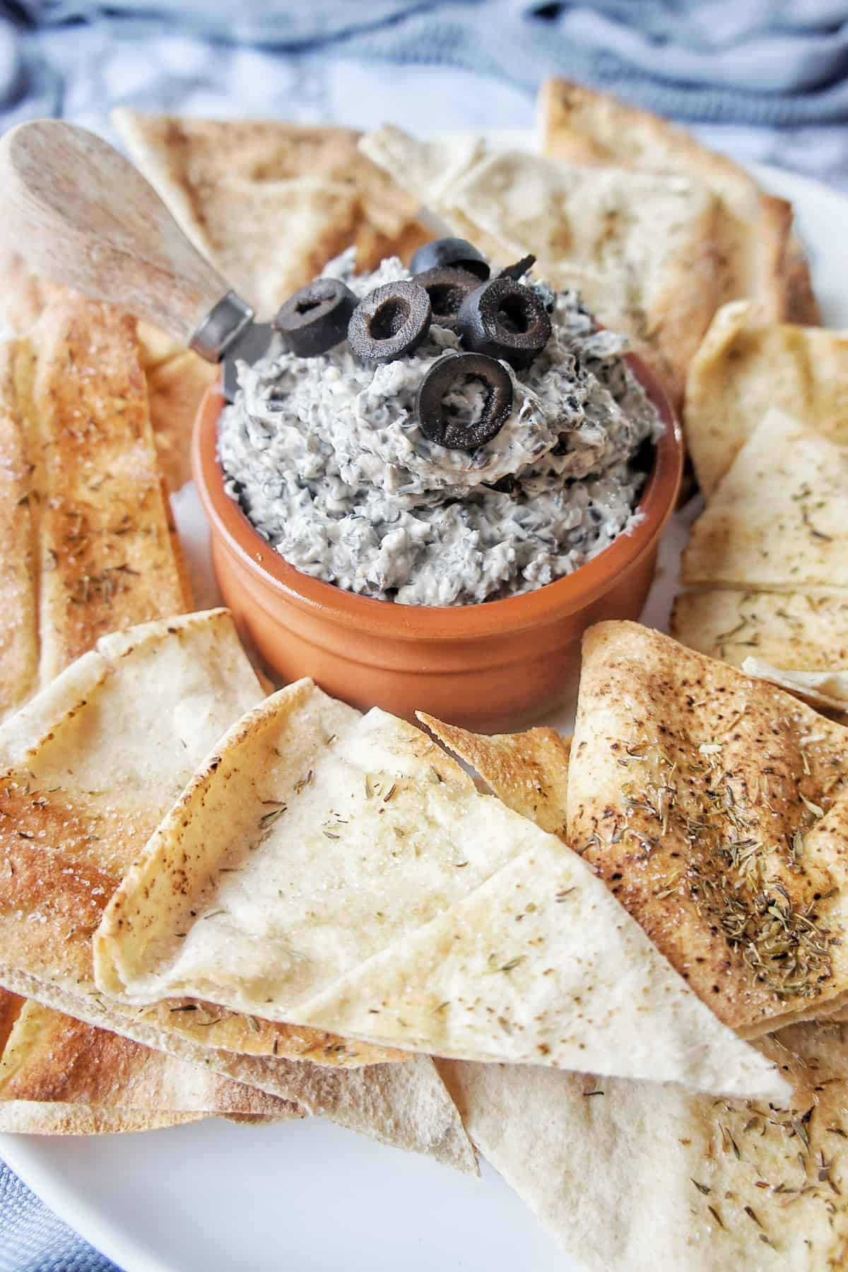 Black Olive Dip on plate with pita chips