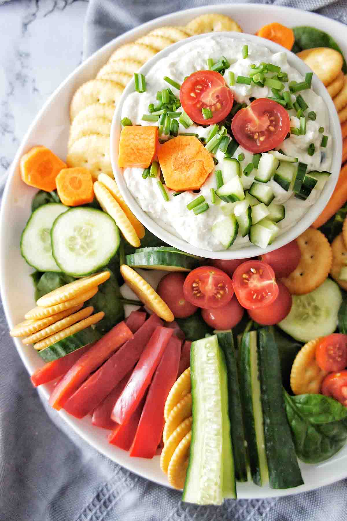 Cottage Cheese Dip on a large platter with veggies and crackers