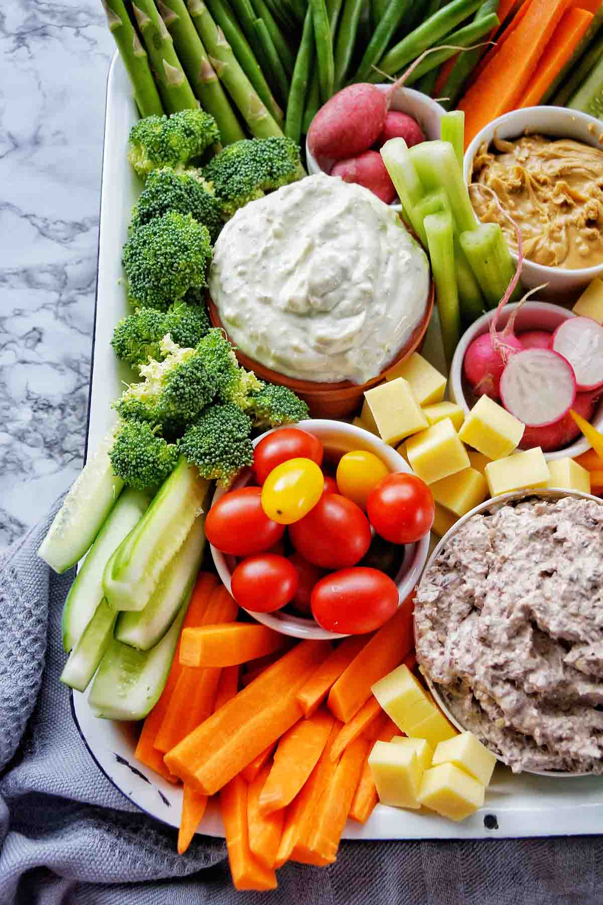 Carrots celery tomatoes and dip in vegetable tray