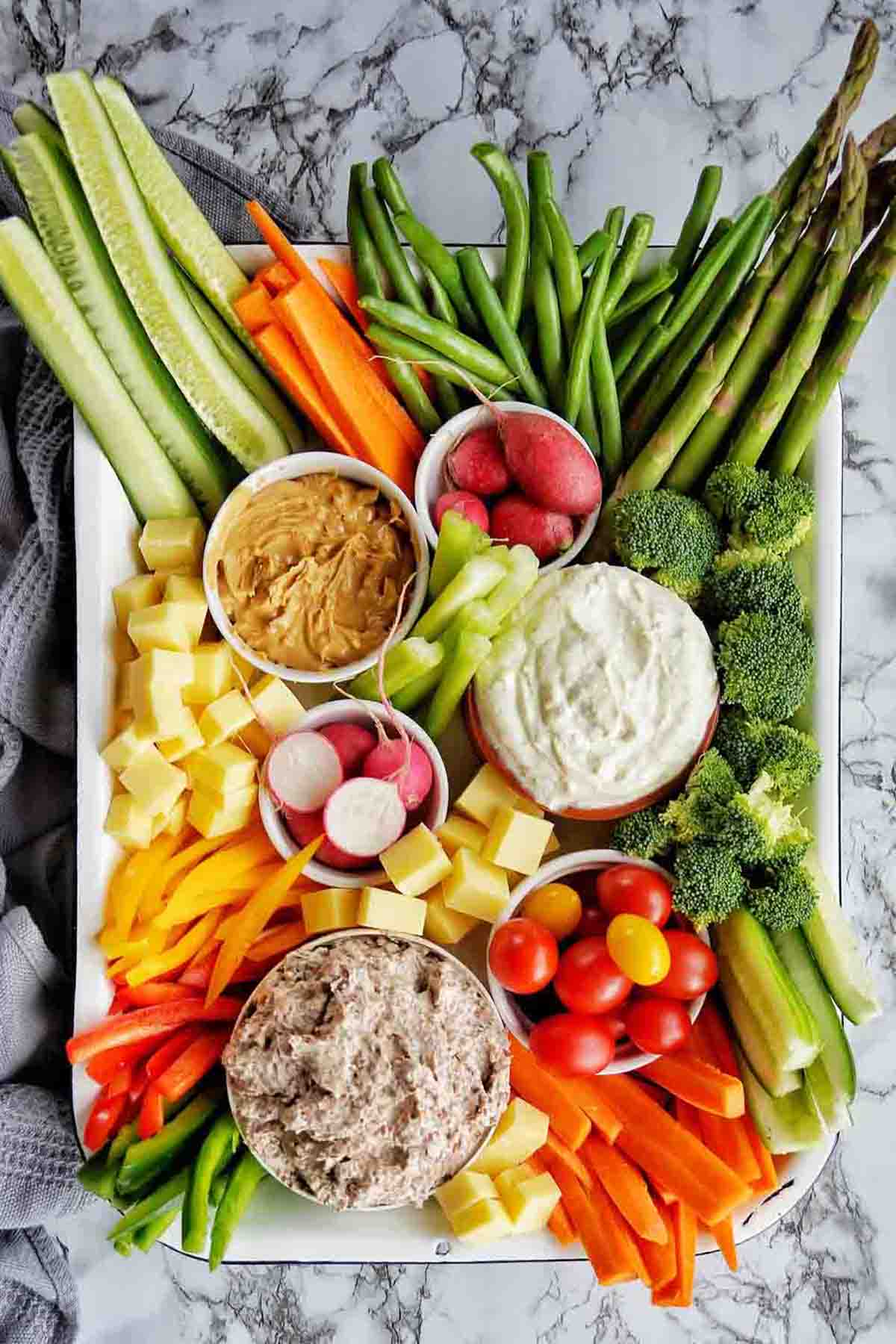 Crudites with dips and cheese in large white platter