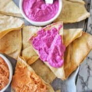Dips and pita chips on a large platter board