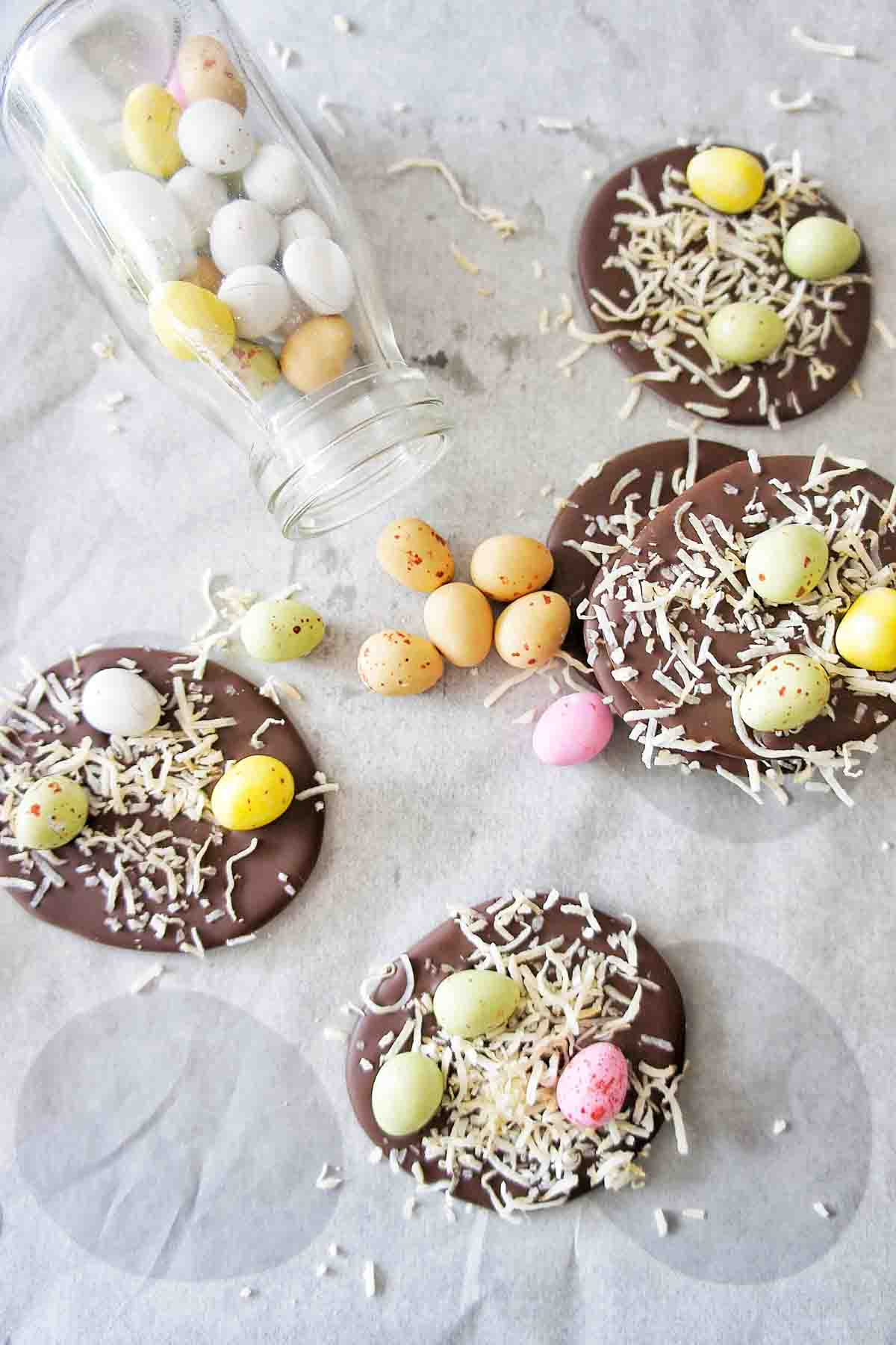 Easter Chocolate Bark on baking paper with additional mini eggs