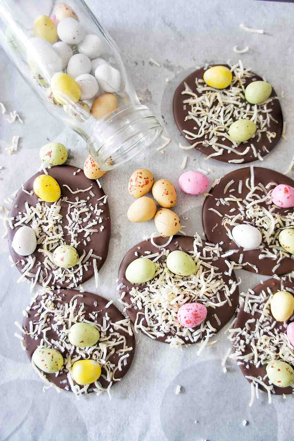 Easter Bark on a white background with coloured speckled eggs