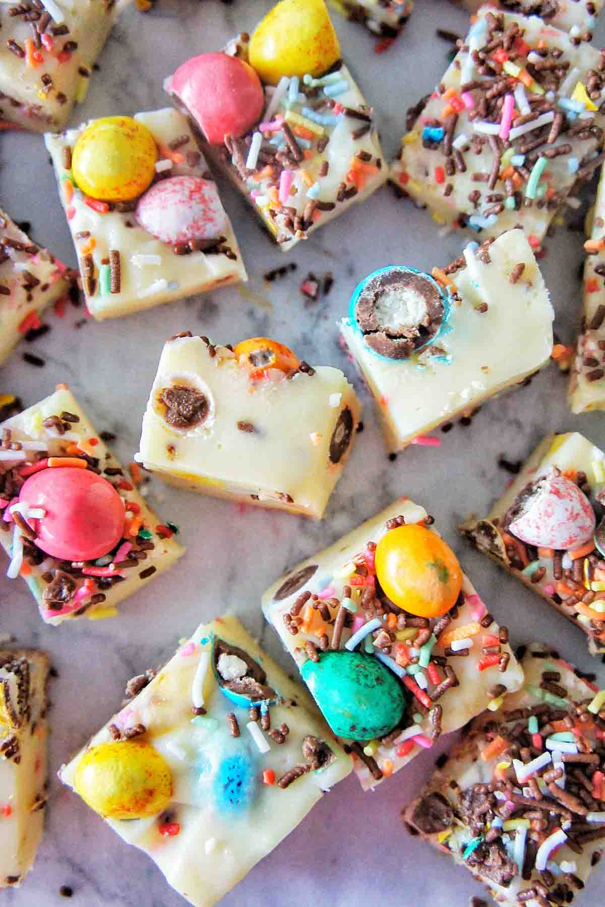 Easter Fudge cut into pieces on a white background