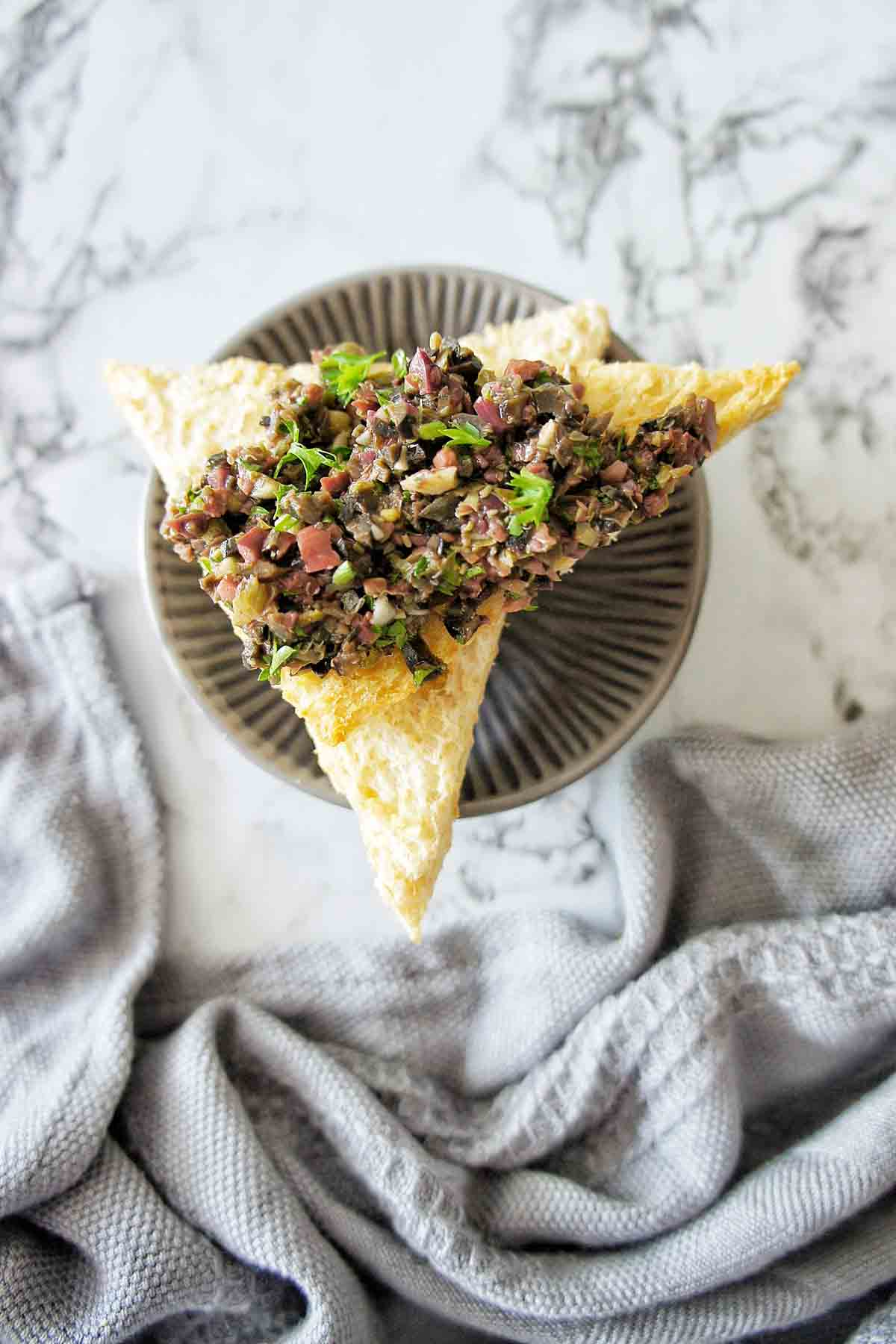 Black Olive Tapenade spread on toast points