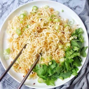Easy Garlic Noodles on a white plate with chopsticks