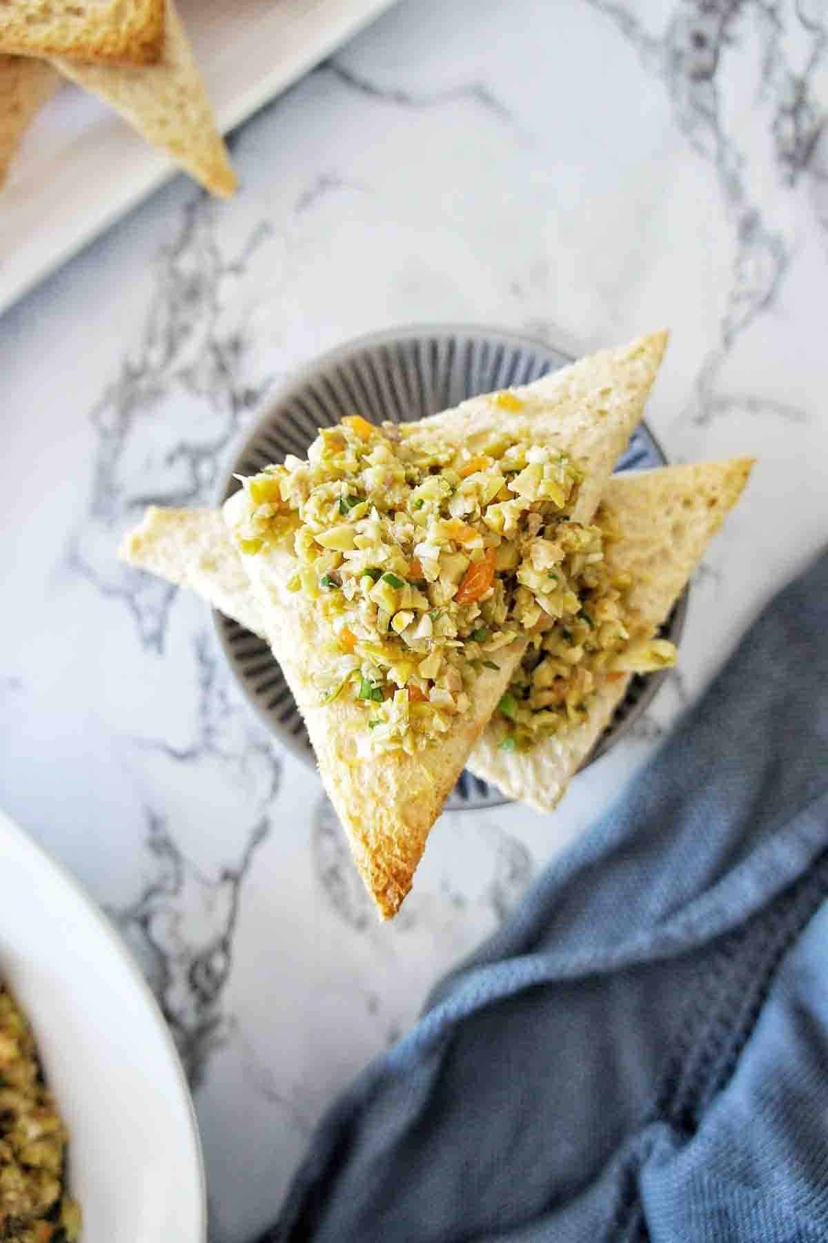 Toast points with green olive tapenade on top
