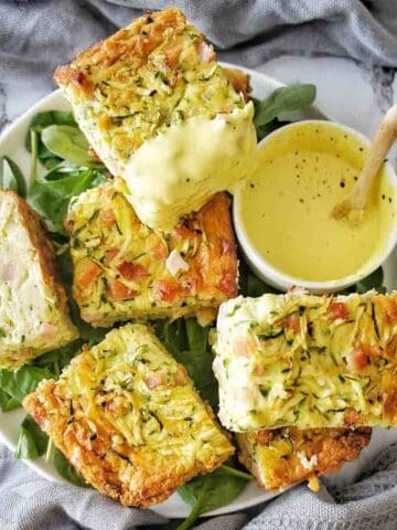 Zucchini Slice pieces on a plate with yellow sauce