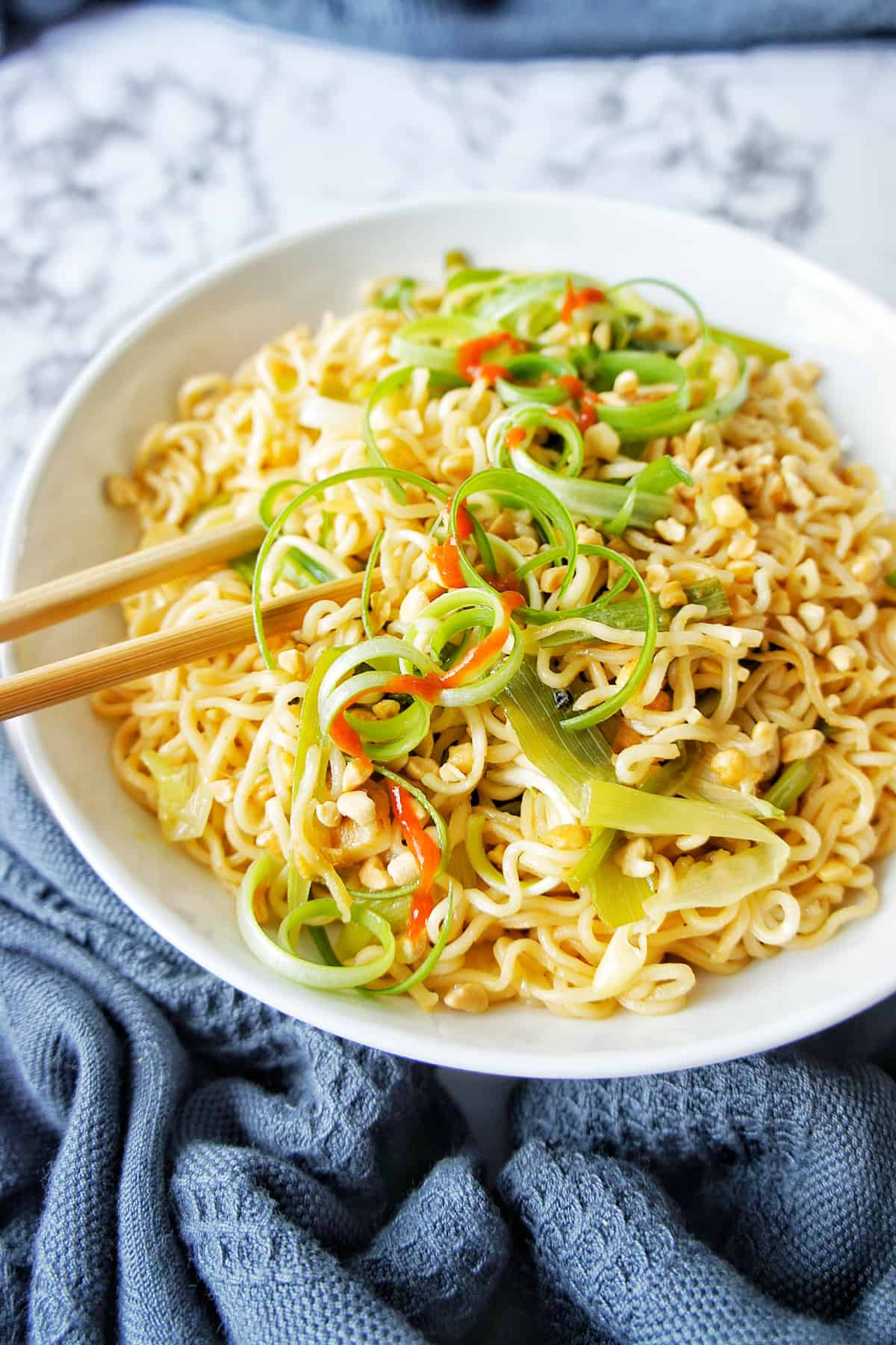 Ginger Scallion Ramen Noodles in a bowl with chopsticks