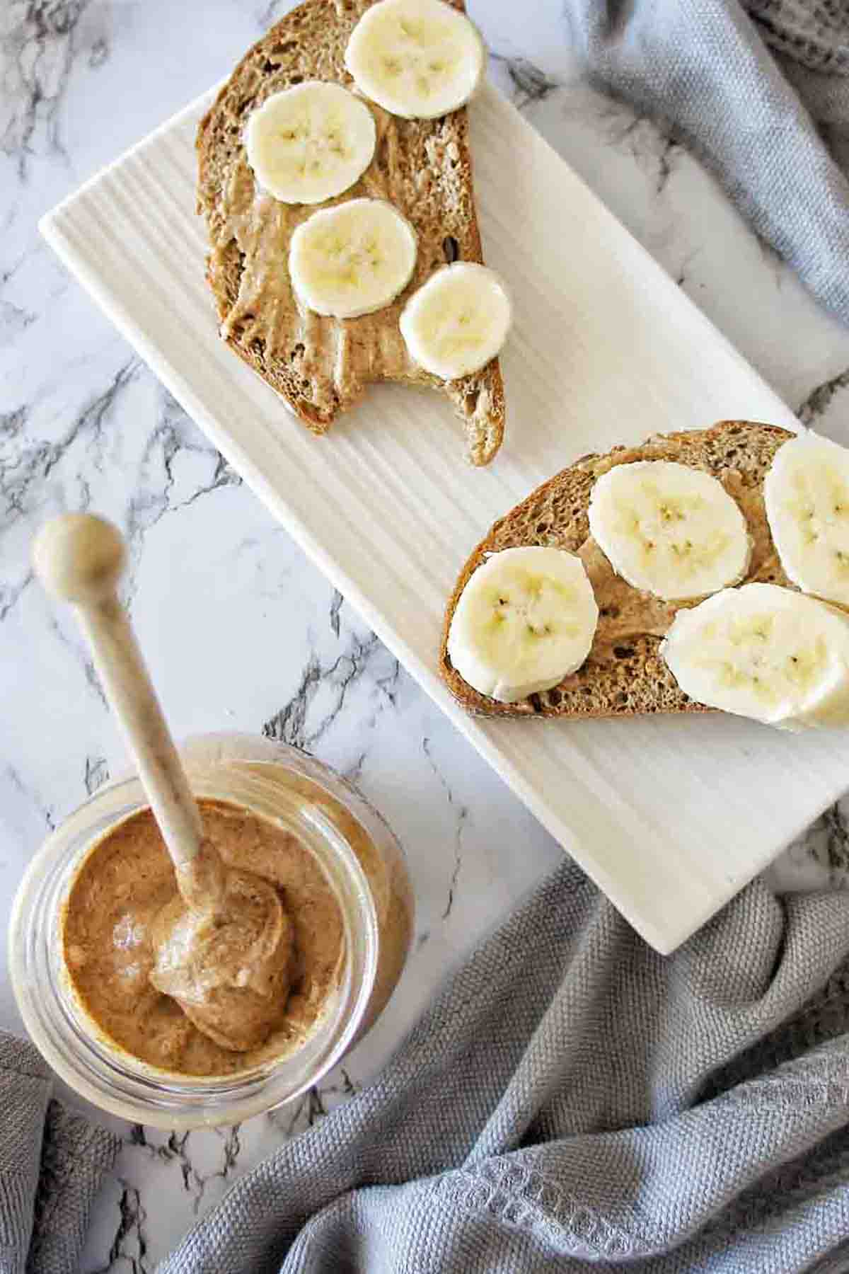 Almond Butter spread on rye bread with sliced bananas