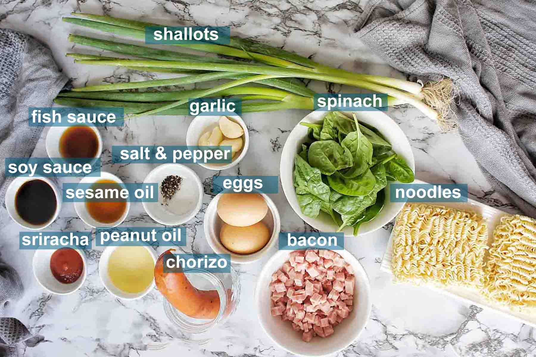 Ingredients for Hungover Noodles recipe on marble background with text over lay