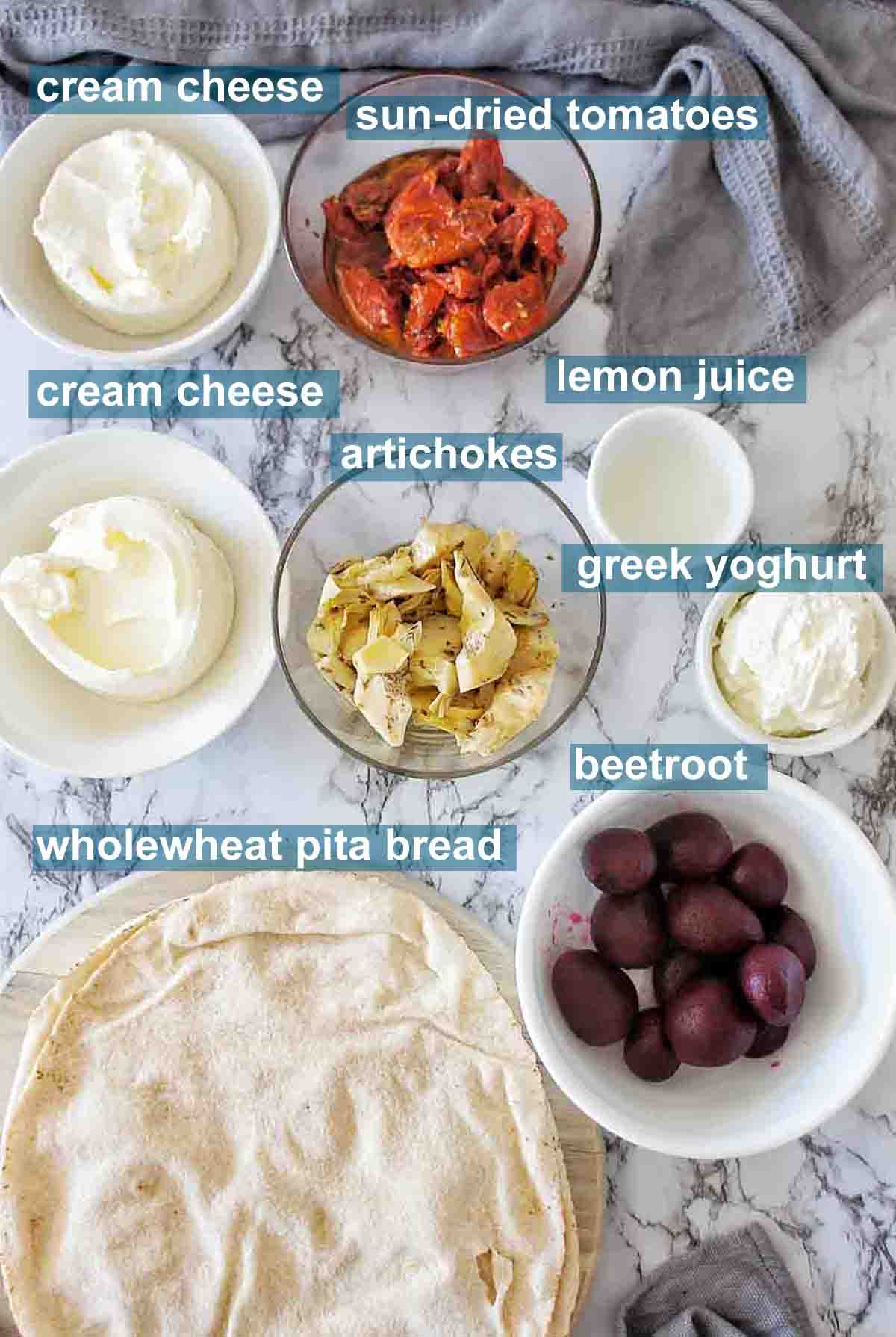 Ingredients set out on a marble background for making a dip platter with text over lay