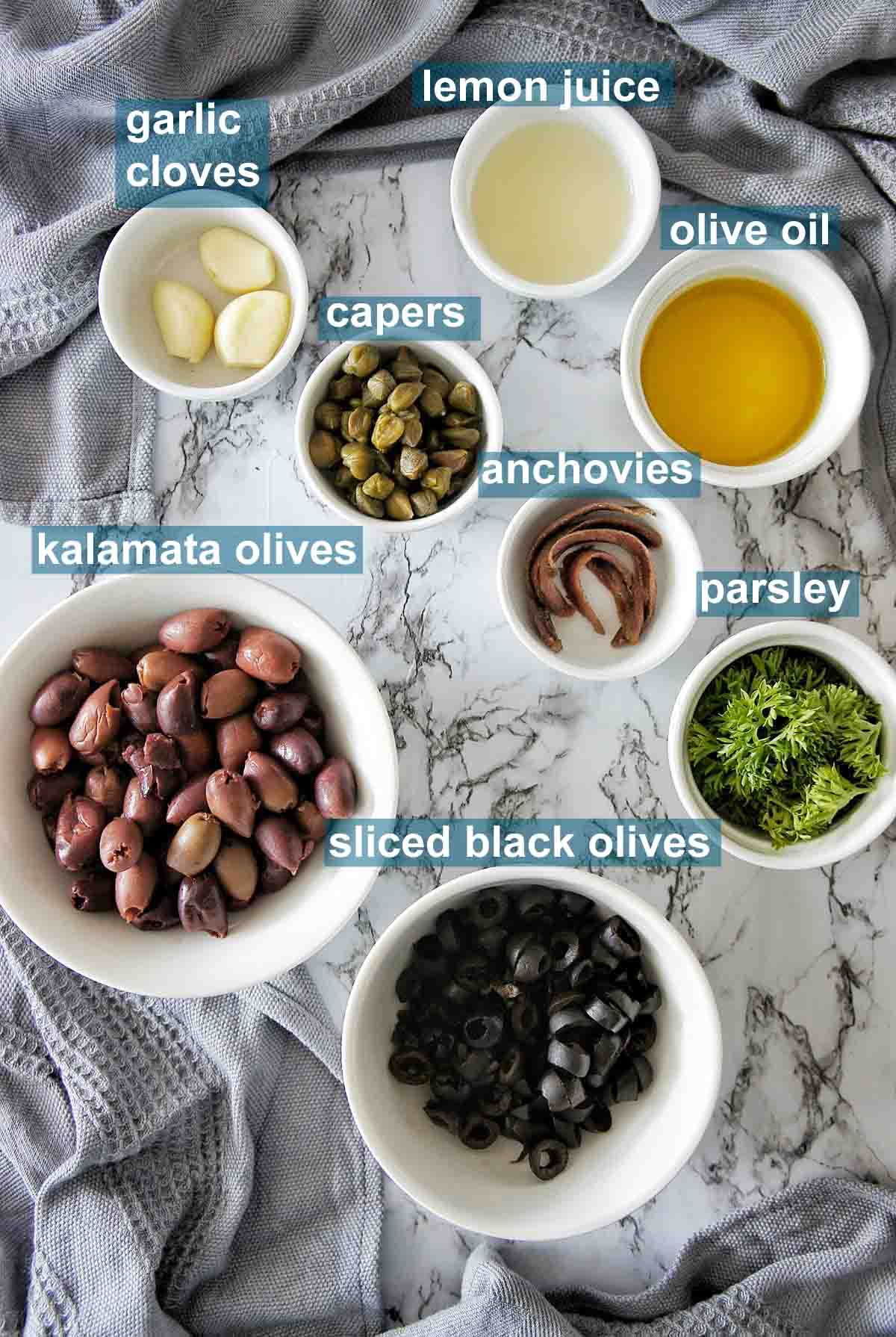 Ingredients for olive tapenade with text overlay