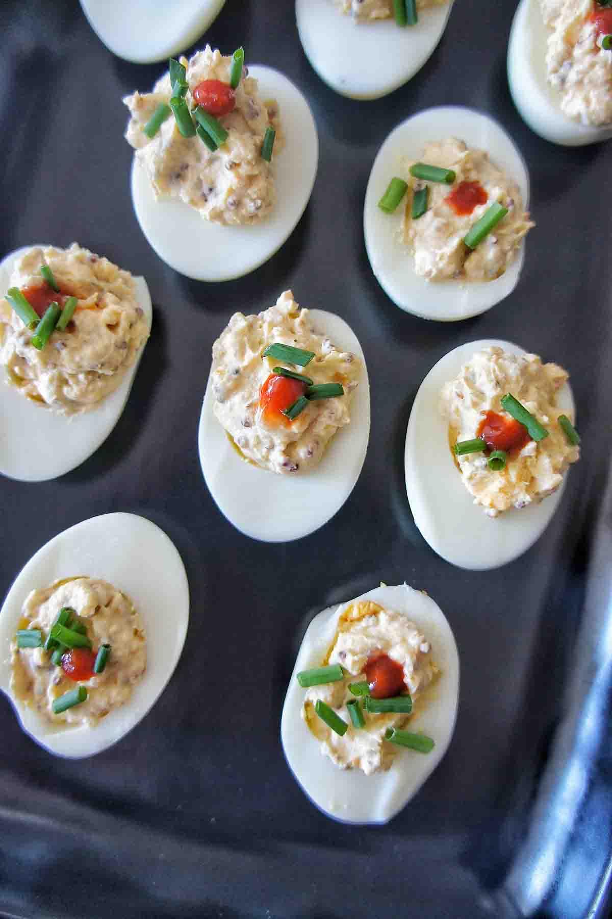 Instant Pot Deviled Eggs on black plate