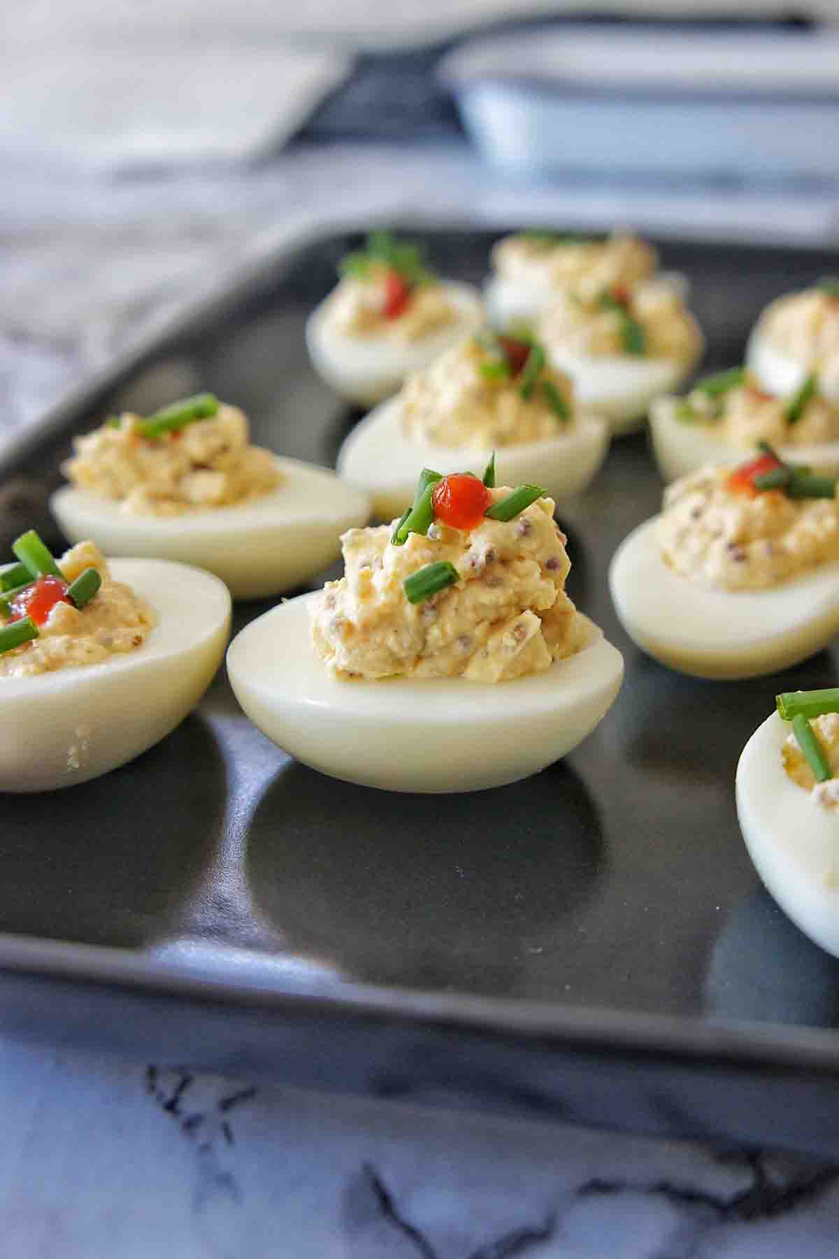 Instant Pot Deviled Eggs on a black plate